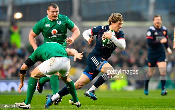 France's scrum-half Baptiste Serin vies with Ireland's full back Rob Kearney during the Six Nations international rugby union match between Ireland...