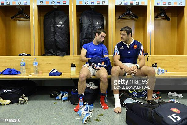 France's scrumhalf Morgan Parra chats with number eight Damien Chouly in the locker room at the end of the rugby union test match between France and...