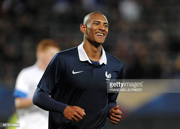 France's Sebastien Haller celebrates after scoring during the friendly Under 21 football match between France and Estonia on March 25 2015 at the...