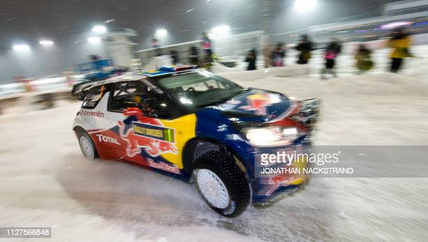 France's Sebastien Loeb and codriver Monaco's Daniel Elena steer their Citroen DS3 during the first stage of the WRC Rally of Sweden at the...