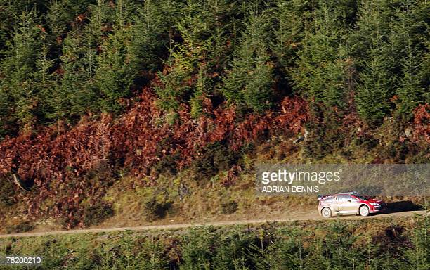 France's Sebastien Loeb drives a Citroen C4 during Stage 7 Crychan near Llandovery during the Wales Rally GB 01 December 2007 Loeb starts the rally...