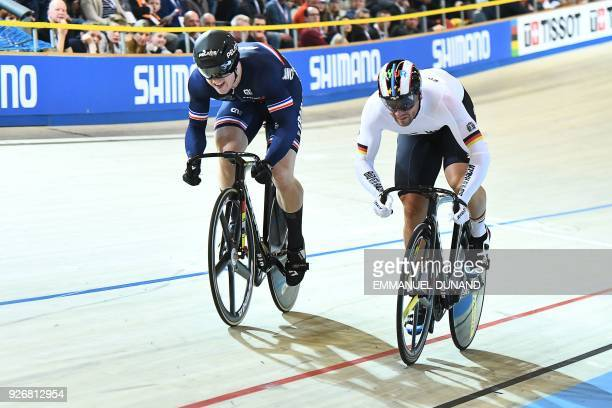 France's Sebastien Vigier and Germany's Maximilian Levy compete in the men's sprint bronze medal race during the UCI Track Cycling World...