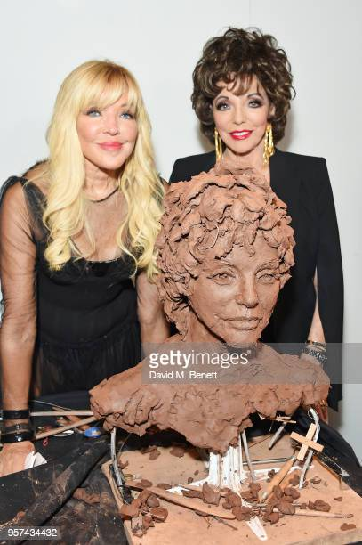 Frances Segelman and Dame Joan Collins pose at a live sculpting in support of Penny Brohn UK Charity at the London Film Museum on May 11 2018 in...
