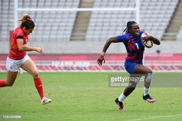 France's Seraphine Okemba breaks away from Britain's Abbie Brown to score a try during the women's rugby sevens semi-final match between France and...