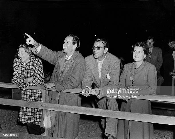Frances Seymour with actor Henry Fonda actor Gary Cooper with wife Veronica Balfe at Hollywood Park Racetrack in Los Angeles California