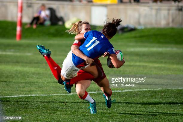 TOPSHOT France's Shannon Izar gets tackled by Canada's Julia Greenshields during their game at the HSBC USA Women's Sevens tournament at Infinity...