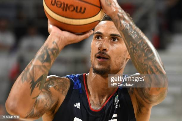 France's shooting guard Edwin Jackson scores during a friendly basketball match between France and Lithuania ahead of the FIBA EuroBasket 2017...