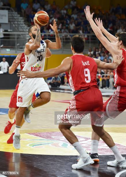 France's shooting guard Evan Fournier vies with Croatia's forward Dario Saric during the friendly basketball match France versus Croatia ahead of the...