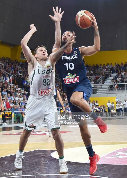France's shooting guard Evan Fournier vies with Lituania's shooting forward Edgaras Ulanovas during a friendly basketball match between France and...