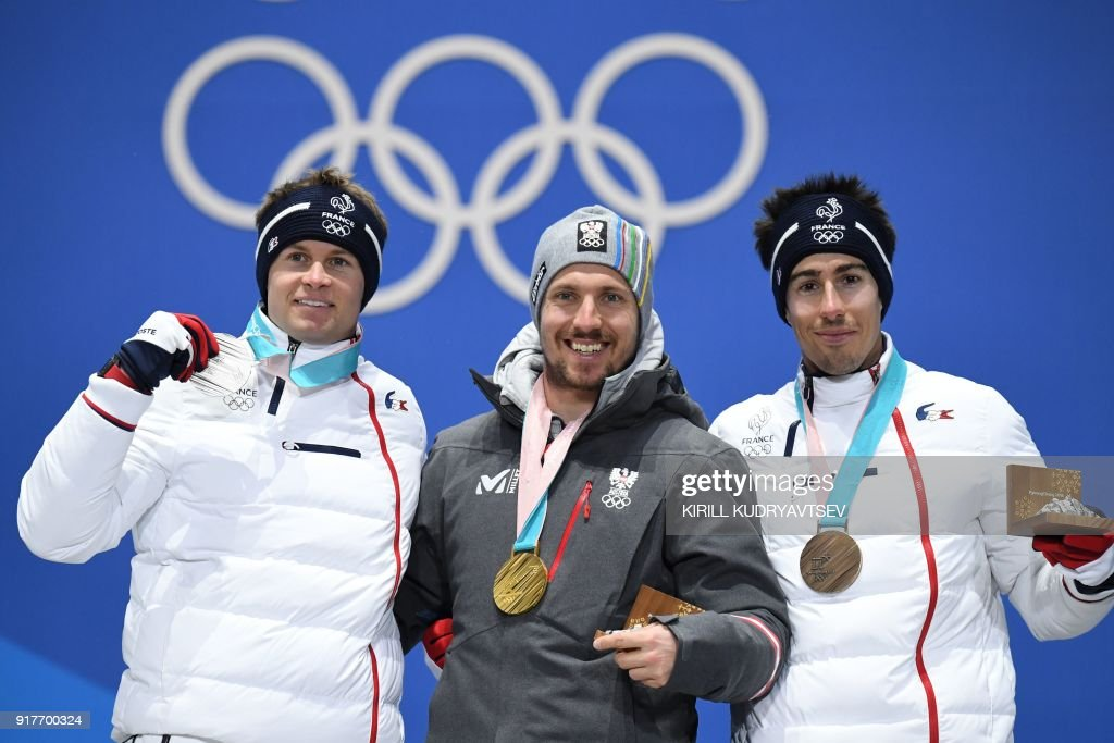 TOPSHOT - (L-R) France's silver medallist Alexis Pinturault, Austria's gold medallist Marcel Hirscher and France's bronze medallist Victor Muffat-Jeandet pose on the podium during the medal ceremony for the Men's alpine skiing combined at the Pyeongchang Medals Plaza during the Pyeongchang 2018 Winter Olympic Games in Pyeongchang on February 13, 2018. / AFP PHOTO / Kirill KUDRYAVTSEV