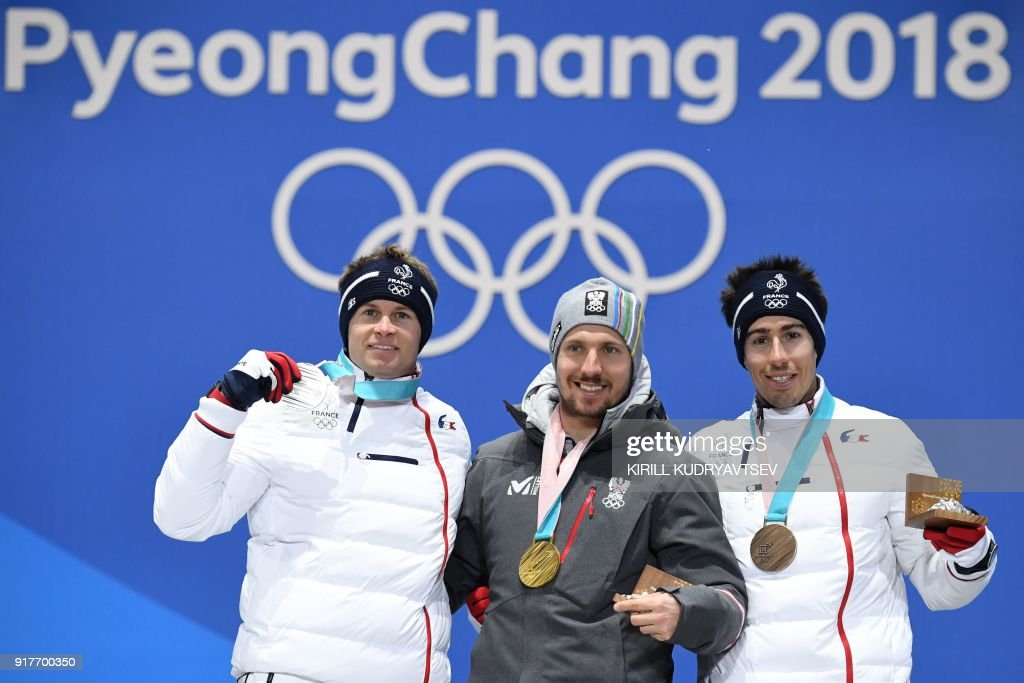 France's silver medallist Alexis Pinturault, Austria's gold medallist Marcel Hirscher and France's bronze medallist Victor Muffat-Jeandet pose on the podium during the medal ceremony for the Men's alpine skiing combined at the Pyeongchang Medals Plaza during the Pyeongchang 2018 Winter Olympic Games in Pyeongchang on February 13, 2018. / AFP PHOTO / Kirill KUDRYAVTSEV