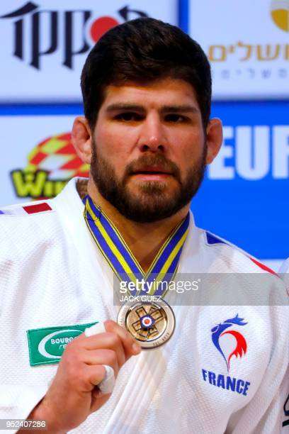 France's silver medallist Cyrille Maret poses on the podium with his medals after the men's under 100 kilograms weight category competition during...