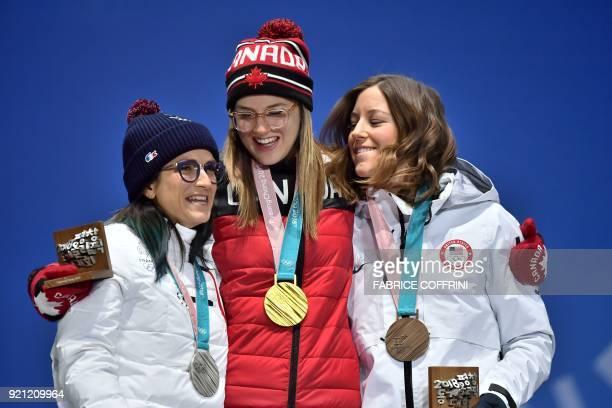 France's silver medallist Marie Martinod Canada's gold medallist Cassie Sharpe and USA's bronze medallist Brita Sigourney pose on the podium during...