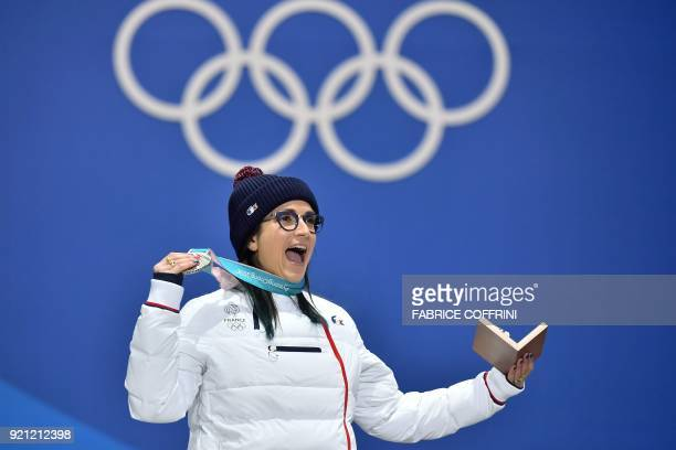 France's silver medallist Marie Martinod celebrates on the podium during the medal ceremony for the freestyle skiing women's halfpipe at the...