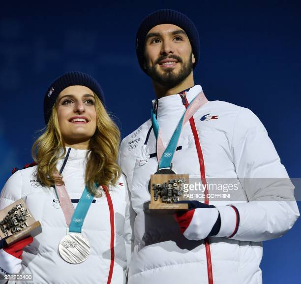 TOPSHOT France's silver medallists Gabriella Papadakis and Guillaume Cizeron pose on the podium during the medal ceremony for the figure skating ice...