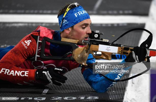 TOPSHOT France's Simon Desthieux competes at the shooting range in the men's 4x75km biathlon event during the Pyeongchang 2018 Winter Olympic Games...
