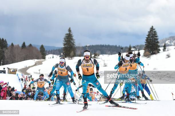 TOPSHOT France's Simon Desthieux Martin Fourcade and Antonin Guigonnat compete during the mass start Premanon French Biathlon Championships on March...