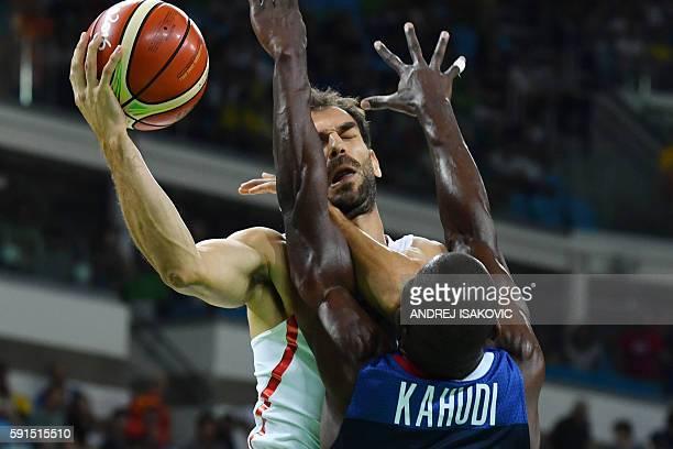 France's small forward Charles Kahudi blocks Spain's point guard Jose Manuel Calderon during a Men's quarterfinal basketball match between Spain and...