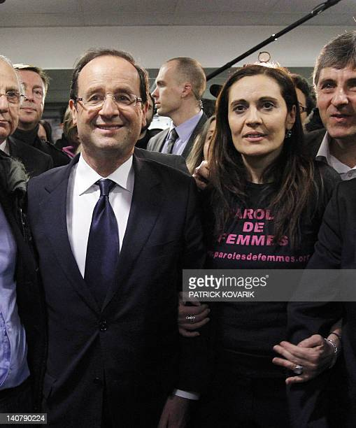 France's Socialist Party candidate for the 2012 French presidential election Francois Hollande and Olivia Cattan president of the feminist...