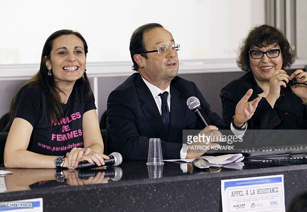 France's Socialist Party candidate for the 2012 French presidential election Francois Hollande flanked by Olivia Cattan president of the feminist...