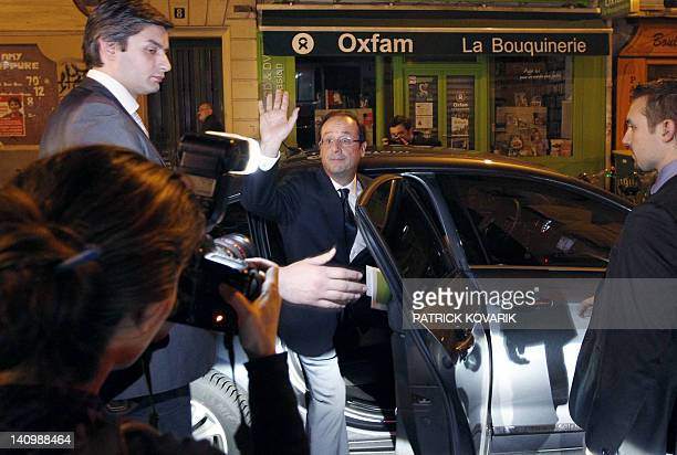 France's Socialist Party candidate for the 2012 French presidential election Francois Hollande waves his supporters as he leaves the ESG Management...