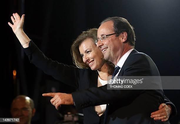 France's Socialist Party newly elected president Francois Hollande celebrates with companion Valerie Trierweiler at the Place de la Bastille in Paris...