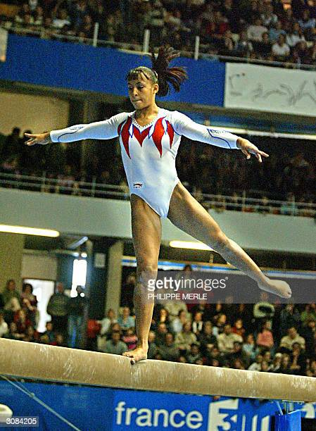 France's Soraya Chaouch performs on the beam during the 13rd French international gymnastics tournament 14 March 2004 in the Gerland arena in Lyon...