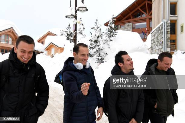 France's Stanley Joseph Renaud Lavillenie Kevin Menaldo and Alexandre Feger leave their hotel before the 'Tignes Open Indoor' pole vault athletics...