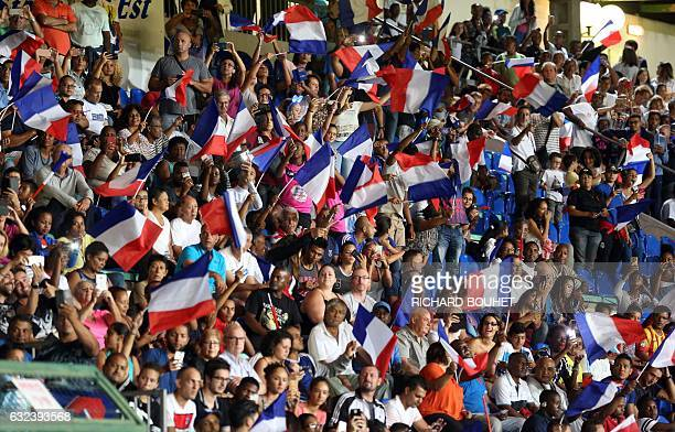 France's supporter cheer their team during the friendly football match between France and South Africa on January 22 2017 at the Jean Ivoula stadium...