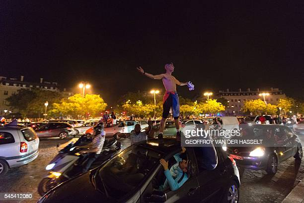 TOPSHOT France's supporters celebrate with smoke flares after France won the Euro 2016 semifinal football match against Germany on the Avenue des...