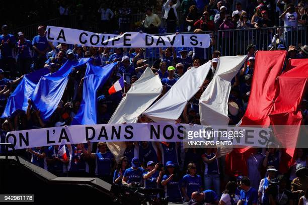 France's supporters cheer during the Davis Cup quarterfinal doubles tennis match Italy vs France at the Valletta Cambiaso Camp in Genova on April 7...