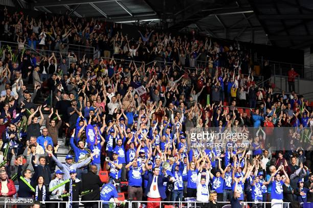 France's supporters cheer during the Davis Cup World Group first round doubles tennis match between France and Netherlands at The Halle Olympique...