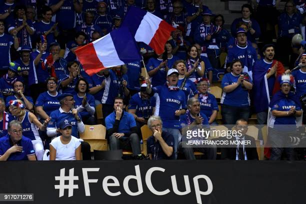 France's supporters cheer during the double tennis match between France's Kristina Mladenovic and Amandine Hesse and Belgium's Kirsten Flipkens and...