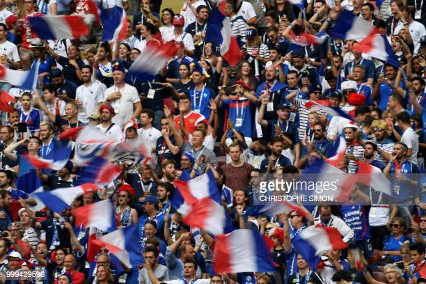 TOPSHOT France's supporters wait ahead of the Russia 2018 World Cup final football match between France and Croatia at the Luzhniki Stadium in Moscow...