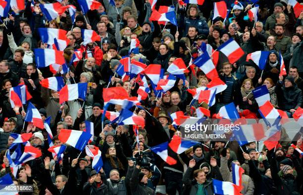 France's supporters wave French flags during the Six Nations international rugby union match between France and Scotland on February 7, 2015 at the...