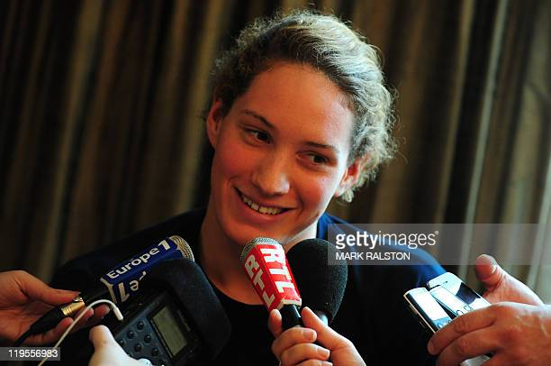 53b67ac13a34 France's swimmer Camille Muffat talks to journalists at a press conference  during the FINA World Championships