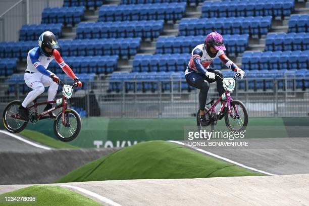 France's Sylvain Andre and Great Britain's Kye Whyte compete in the cycling BMX racing men's quarter-finals run at the Ariake Urban Sports Park...