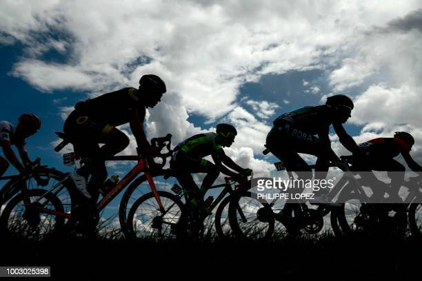 France's Sylvain Chavanel Belgium's Thomas Degand and Poland's Maciej Bodnar ride in a 32men breakaway during the 14th stage of the 105th edition of...