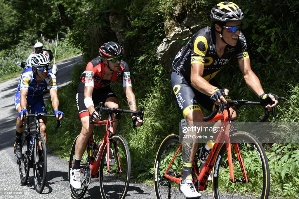 France's Sylvain Chavanel, Italy's Alessandro De Marchi and Belgium's Philippe Gilbert ride in a breakaway during the 101 km thirteenth stage of the 104th edition of the Tour de France cycling race on July 14, 2017 between Saint-Girons and Foix. /