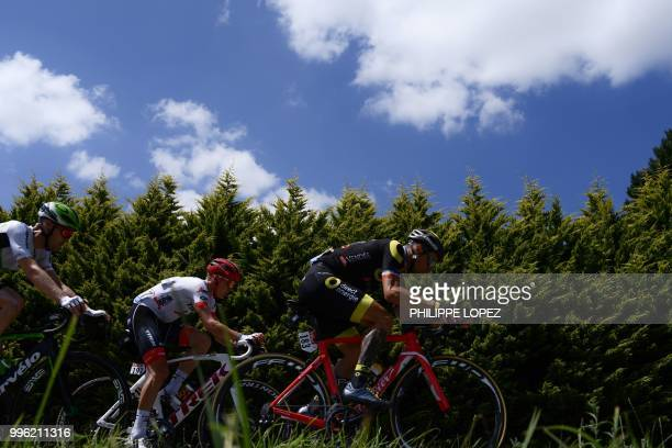 France's Sylvain Chavanel Latvia's Toms Skujins and Belgium's Julien Vermote ride during their sevenmen breakaway in the fifth stage of the 105th...