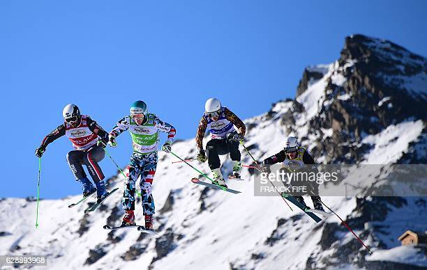 France's Sylvain Maillier Austria's Johannes Rohrweck Canada's Ned Ireland and Italy's Siegmar Klotz compete during the FIS men's quarter final...