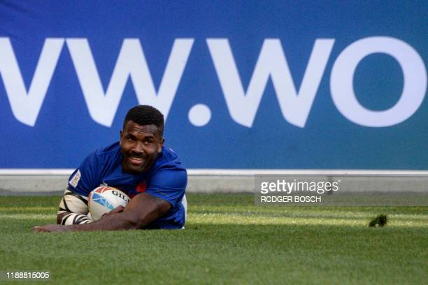 France's Tavite Veredamu reacts after scoring the winning try in extra time during the HSBC World Rugby Sevens Series men's bronze final rugby match...