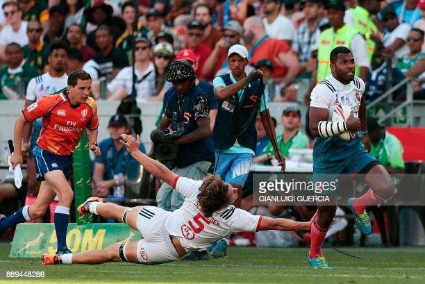France's Tavite Veredamu runs to score a try against USA during their match on the second day of the World Rugby Sevens Series at Cape Town Stadium...
