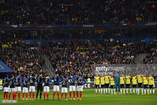 TOPSHOT France's team and Colombia team respect a minute of silence in tribute to the victims of shooting at a supermarket in Carcassonne prior to...