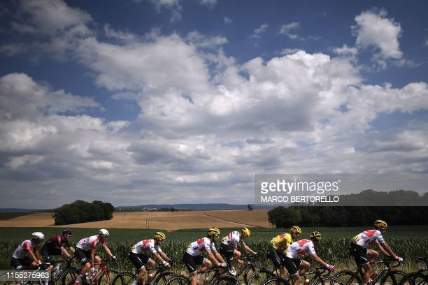 France's Team Arkea-Samsic cycling team riders and other cyclists ride in the countryside during the seventh stage of the 106th edition of the Tour...