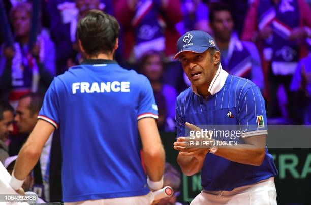 France's team captain Yannick Noah applauds France's Jeremy Chardy during the opening single tennis match against Croatia's Borna Coric as part of...