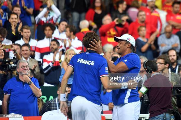 France's team captain Yannick Noah embraces France's Nicolas Mahut after his victory with teammate and Julien Benneteau in their doubles rubber...