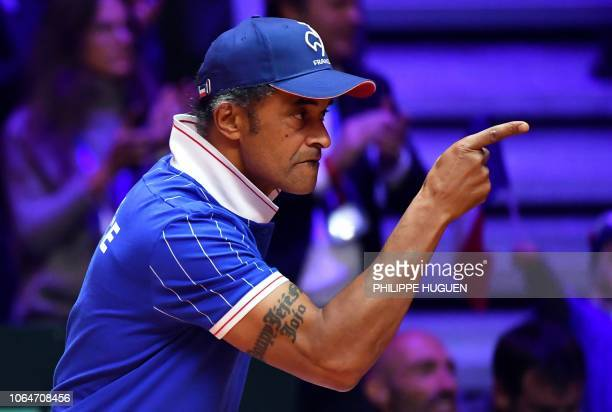 France's team captain Yannick Noah reacts during the doubles rubber for the Davis Cup final tennis match between France and Croatia at the Pierre...
