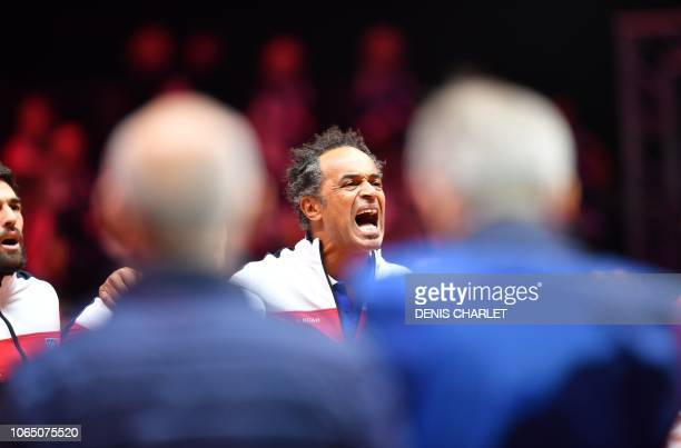 France's team captain Yannick Noah sings the national anthem prior the single tennis match between French Lucas Pouille and Croatian player Marin...