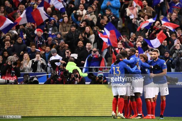 France's team celebrates after France's defender Samuel Umtiti scored a goal during the UEFA Euro 2020 Group H qualification football match between...